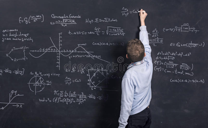 Child doing complex mathematics royalty free stock images
