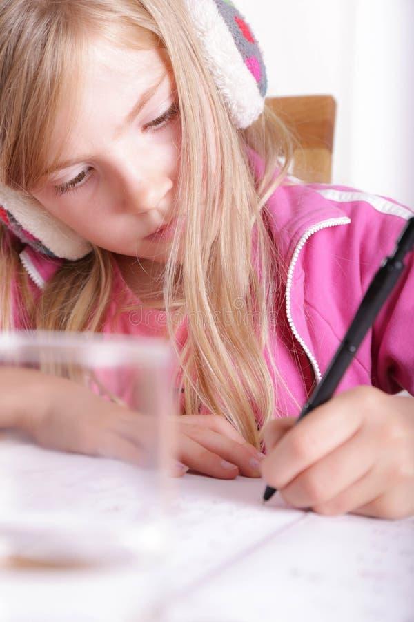 Child doing her homework stock images