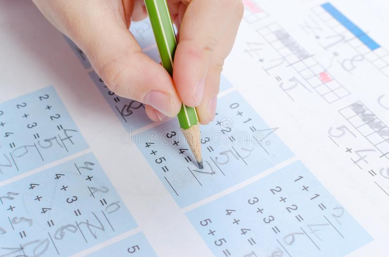 Child is doing homework, math, close up royalty free stock image