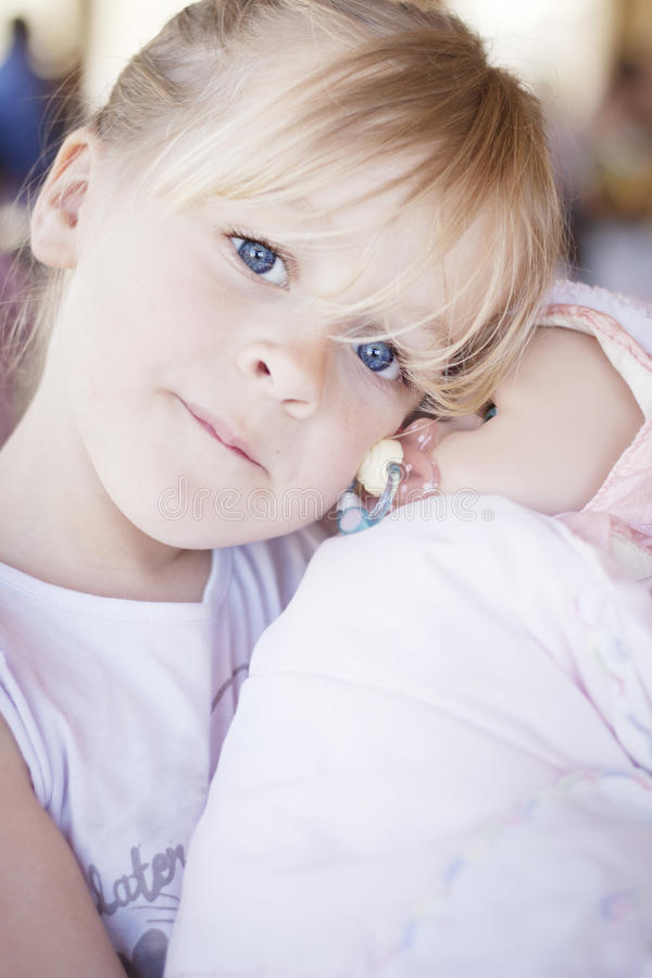 Child with doll stock images
