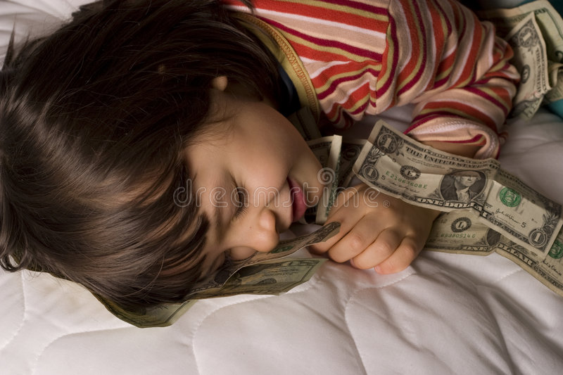 Child and dollars. Child sleep with dollars, money stock photography