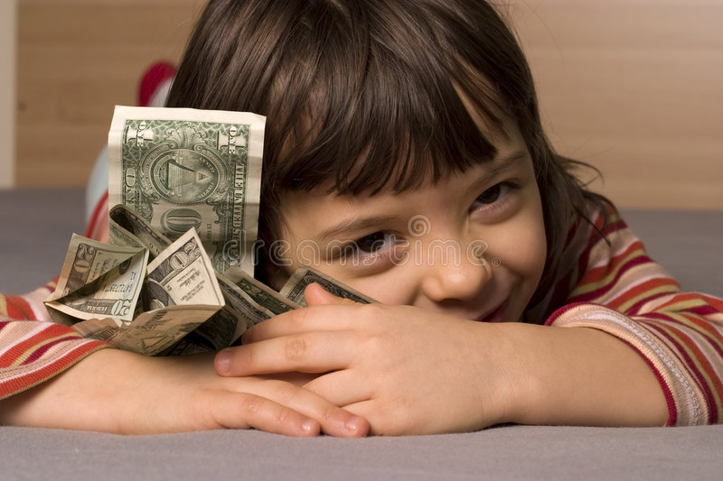 Child and dollars. Smile child and one dollars royalty free stock photo