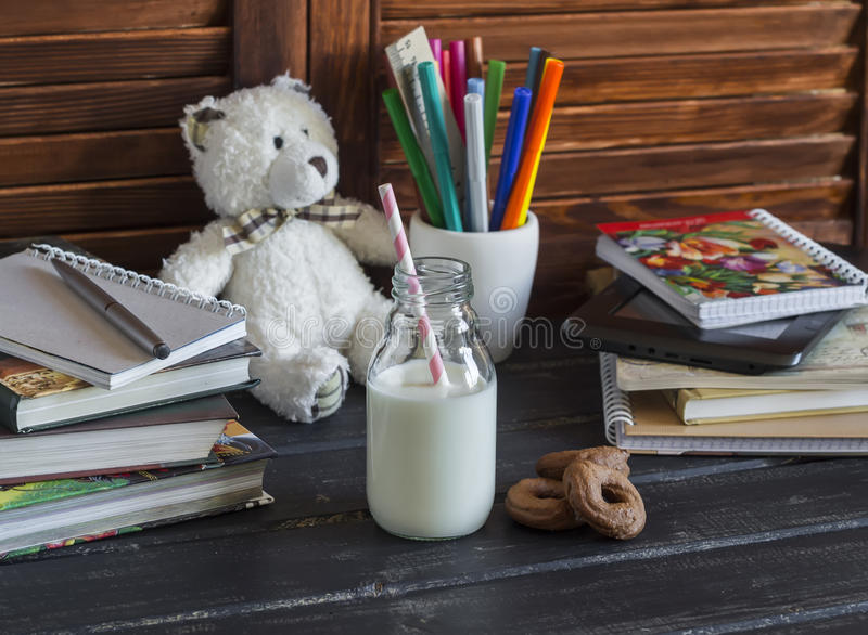 Child domestic workplace and accessories for training and education - books, journals, notepads, notebooks, pens, pencils, table stock photo