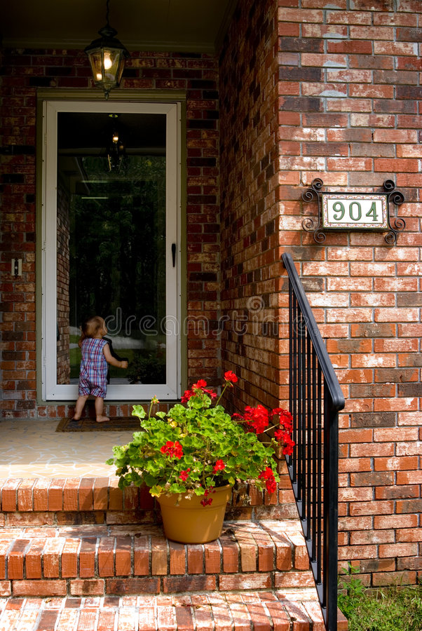 Child at the Door stock photos
