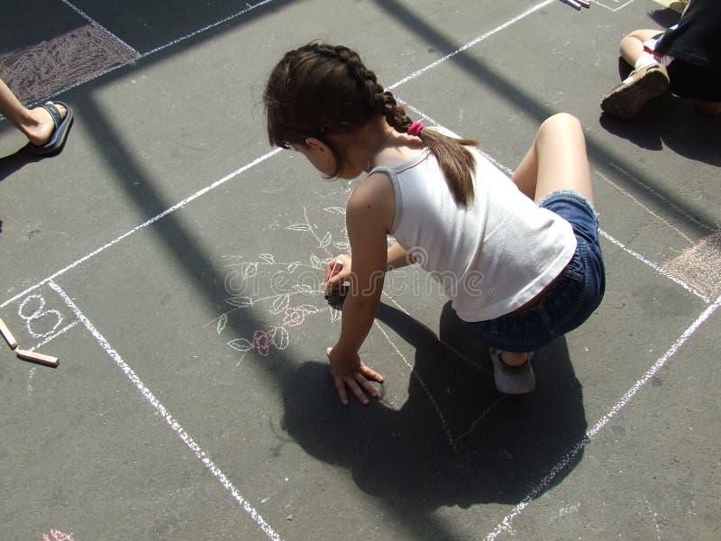 Child Drawing On The Asphalt Chalk Stock Image