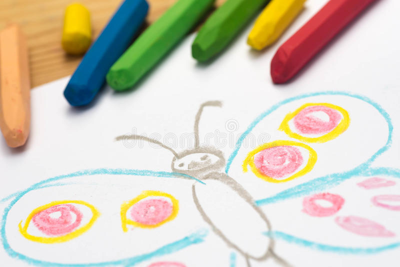 Child drawing, butterfly , selective focus royalty free stock images