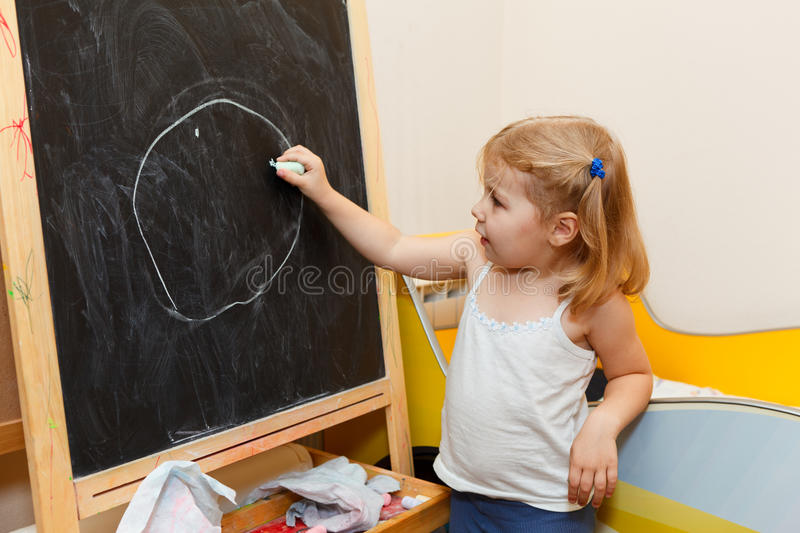 Download Child Drawing With Chalk On Blackboard Stock Image - Image: 22094663
