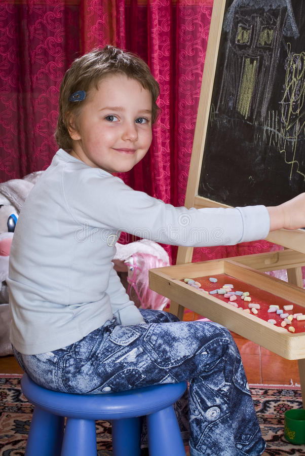Child drawing on chalkboard royalty free stock photos
