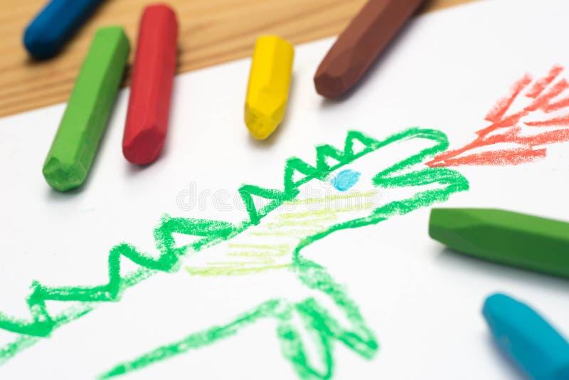 Child drawing, dragon , selective focus stock image
