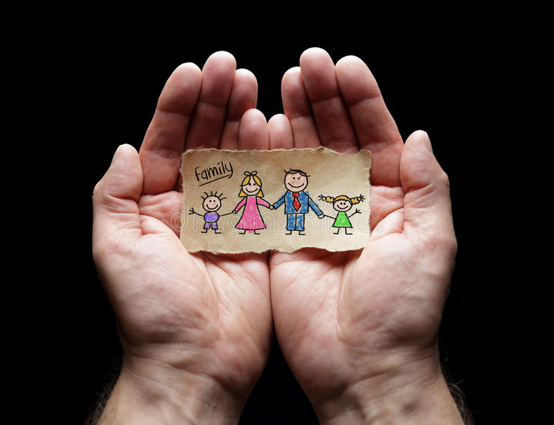 Child drawing of family with the protection of cupped hands. Family care with the protection of cupped hands, concept for love, help, assistance, security and royalty free stock photography