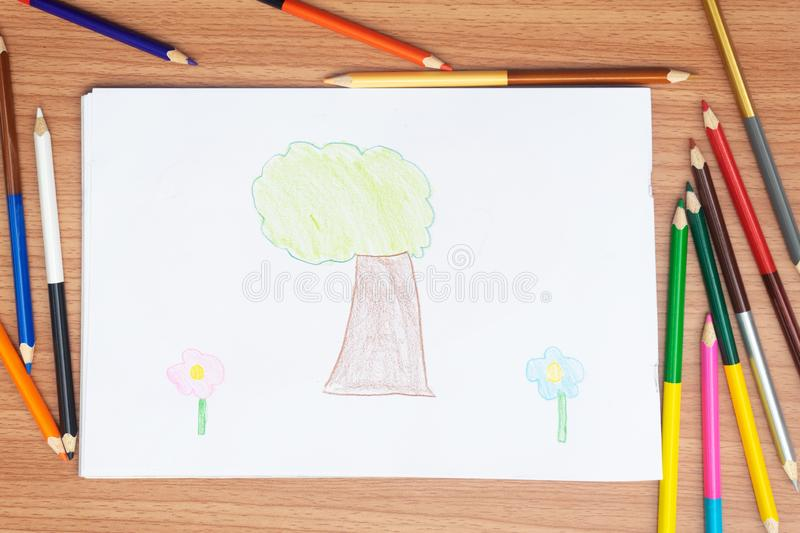 Child drawing home, drawing with pencil painting picture on paper, artwork workplace stock image