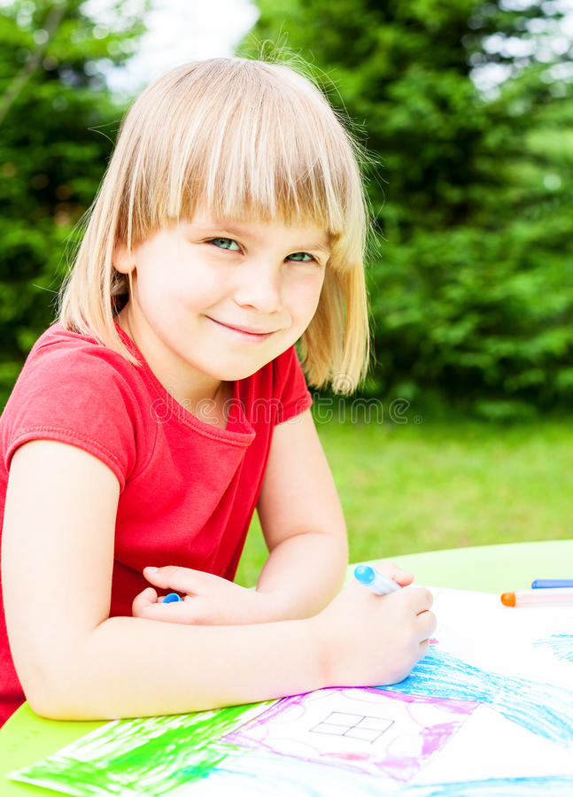 Download Child drawing outdoors stock image. Image of coloring - 41757921