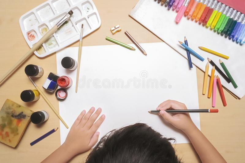 Child drawing on paper royalty free stock photos