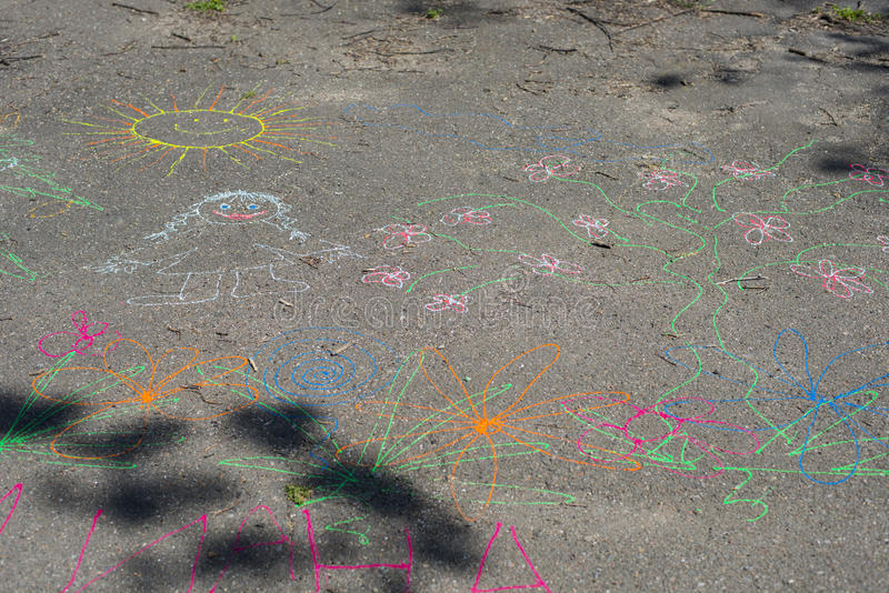 Child drawing on the pavement. royalty free stock photo