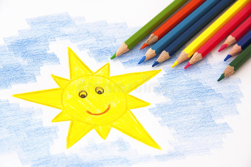 Child drawing with pencils royalty free stock photography