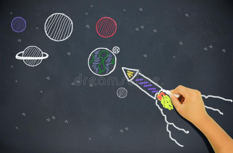 Child drawing a rocket stock images