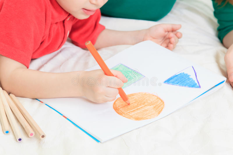 Child drawing shapes stock photography