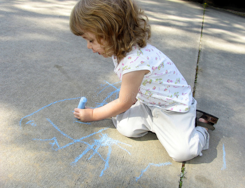 Child drawing on sidewalk stock photos