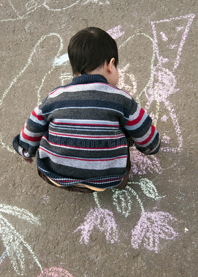 Free Child Drawing With Chalk Stock Photography - 35374142