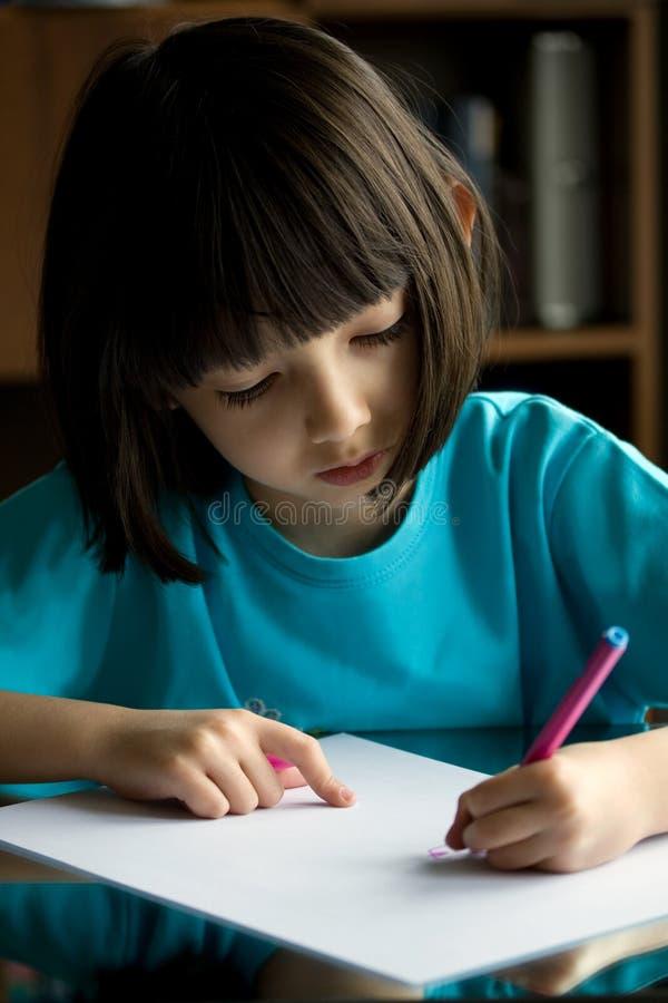 Child draws. stock image