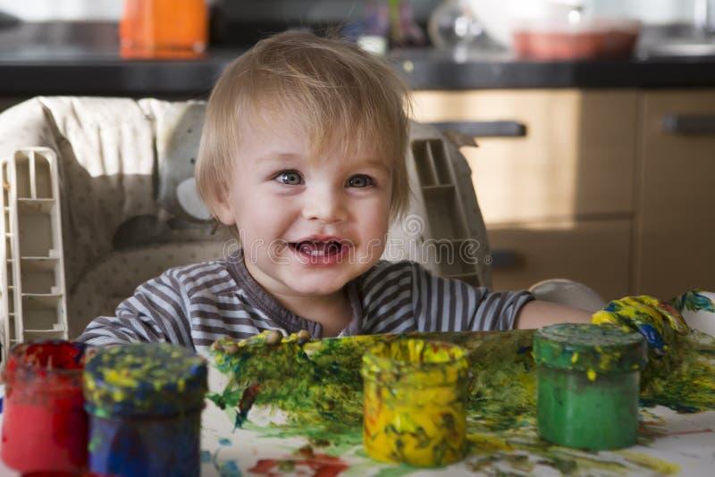 The child draws stock photo