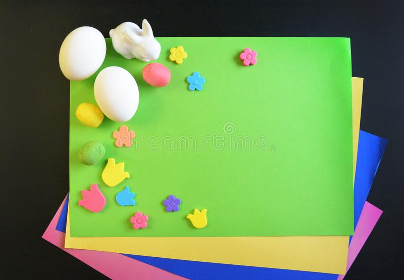 Making a scrapbooking hand made easter card. A child draws gift items. Hand-made. The project of children`s creativity, needlework, crafts for children. Making a royalty free stock photography
