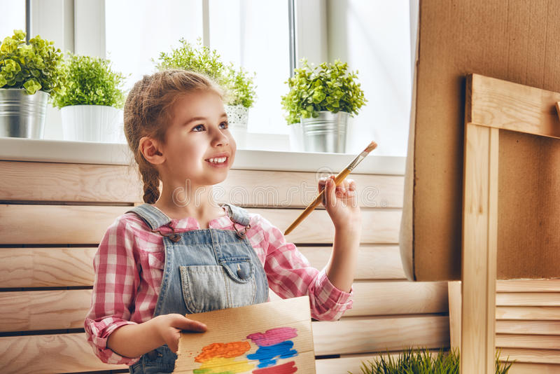 Child draws paints royalty free stock photo