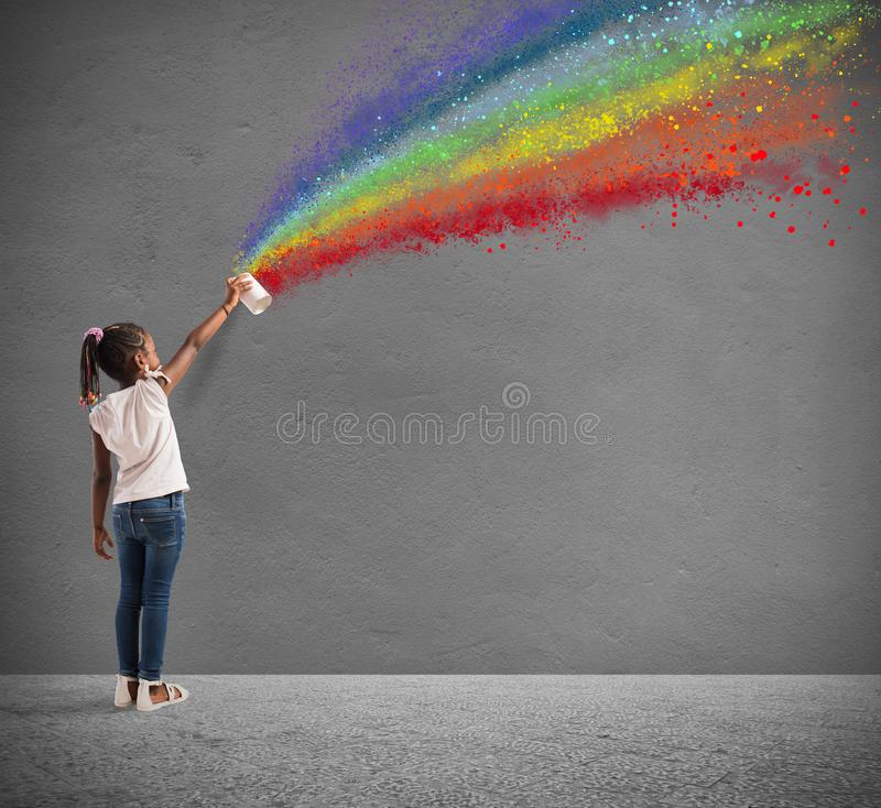 Child draws with spray the color of peace stock image