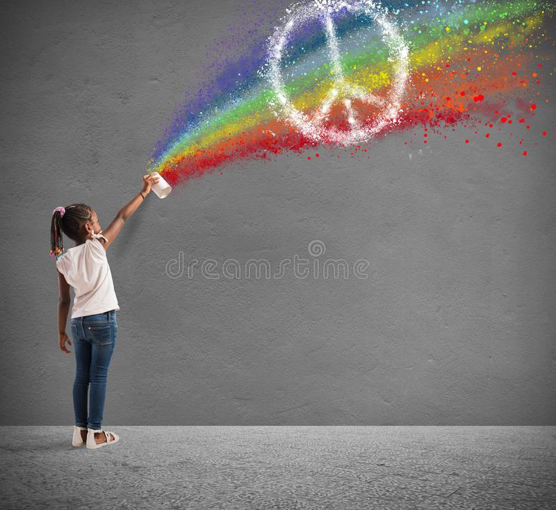 Child draws with spray the color of peace royalty free stock photography