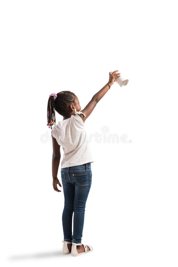 Child draws with spray in a wall royalty free stock photography