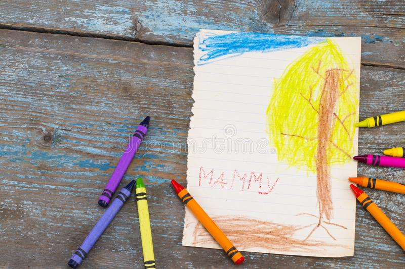 The child draws a tree . Handmade. Project of children`s creativ royalty free stock photos