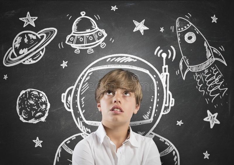Child dreamer. Child who dreams of being in space with open eyes stock photography