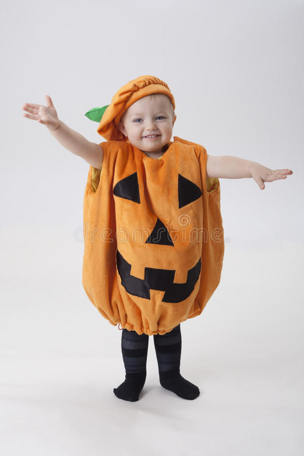 Download Child Dressed As A Pumpkin On Halloween Stock Image - Image: 28787427