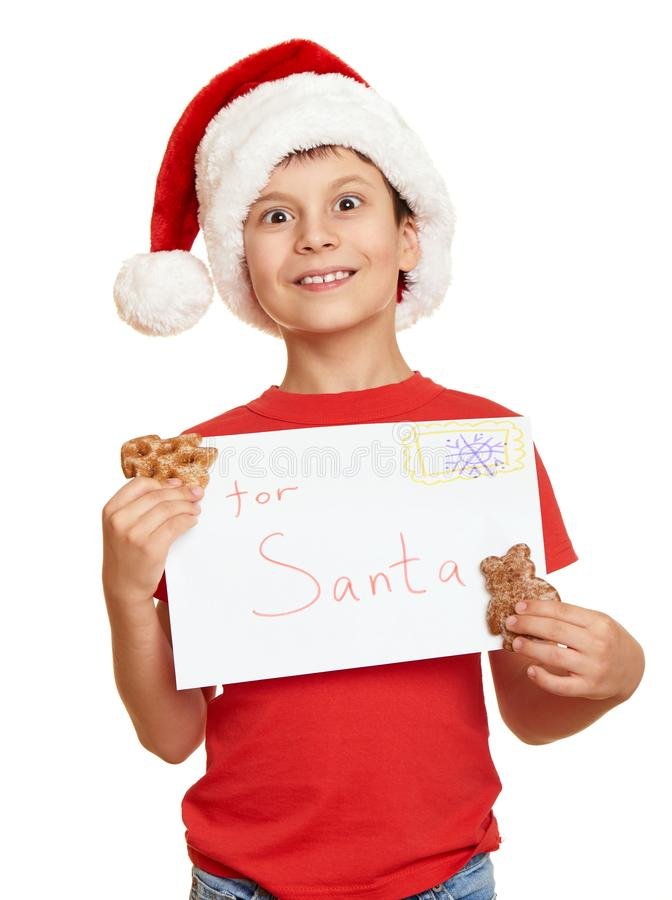 Child dressed in santa hat isolated on white background. New year eve and winter holiday concept. stock photo