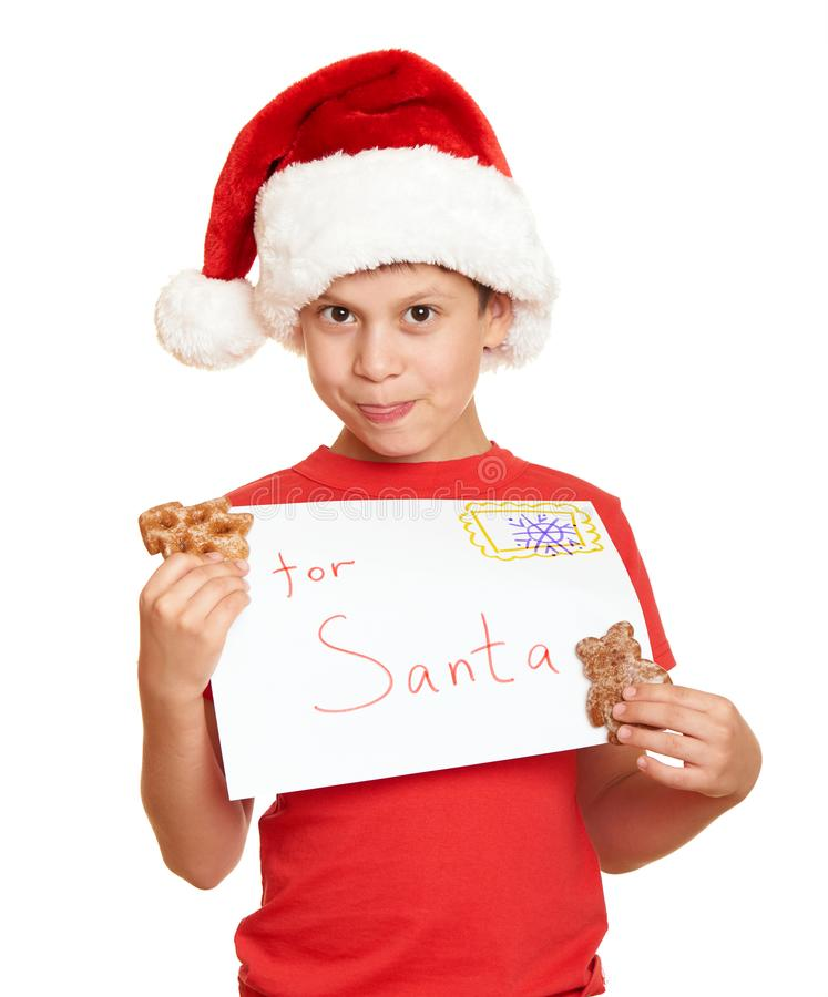 Child dressed in santa hat isolated on white background. New year eve and winter holiday concept. royalty free stock photography