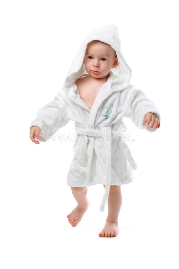 Child in a dressing gown stock images