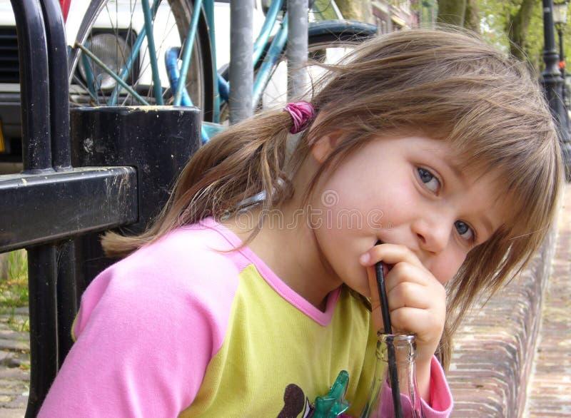 Child drinking stock image