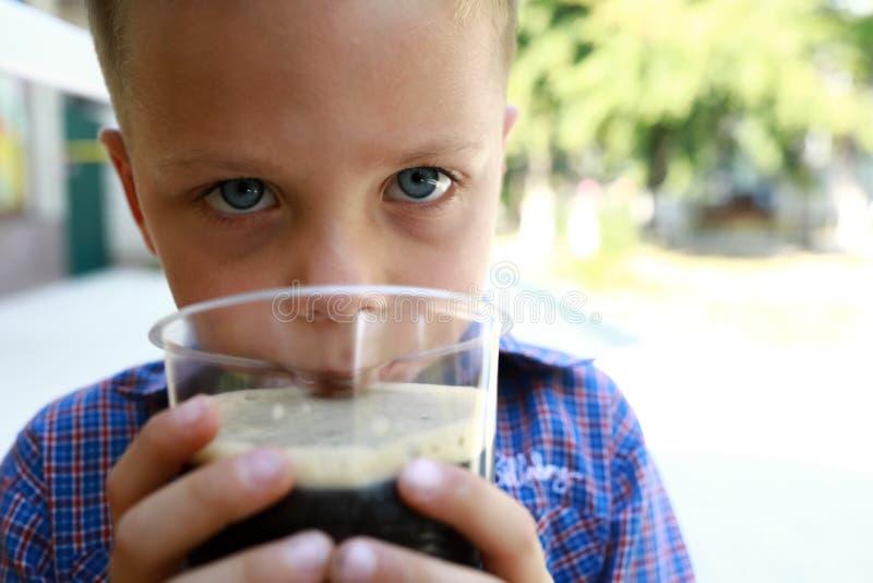 Child drinking kvass royalty free stock image
