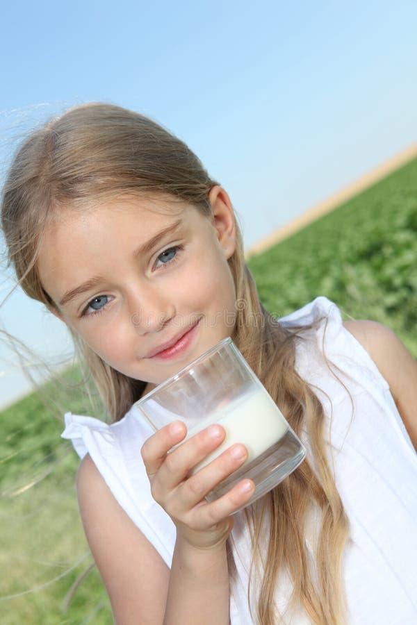 Child drinking milk stock image