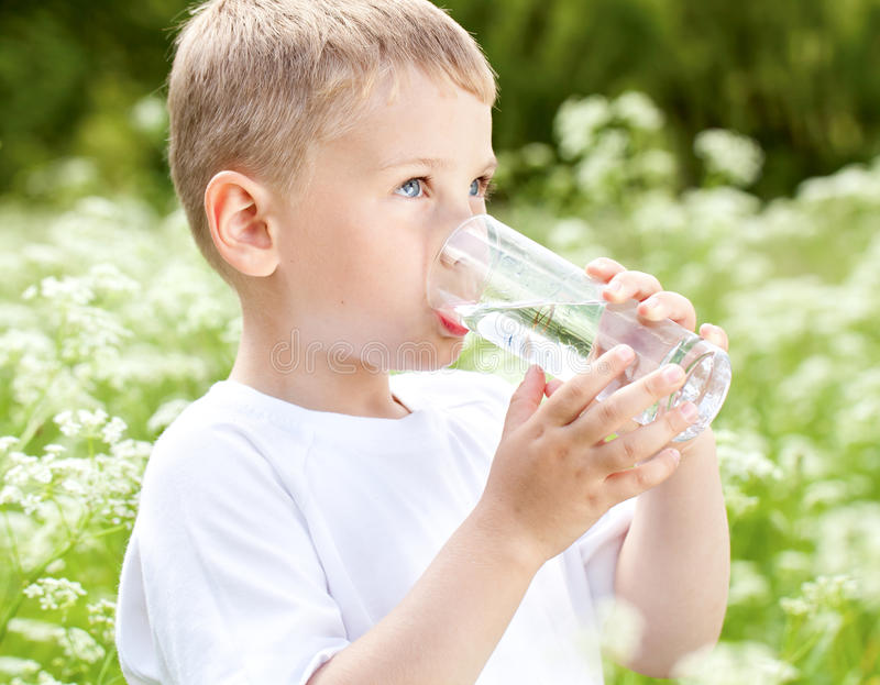 Child drinking pure water royalty free stock photography
