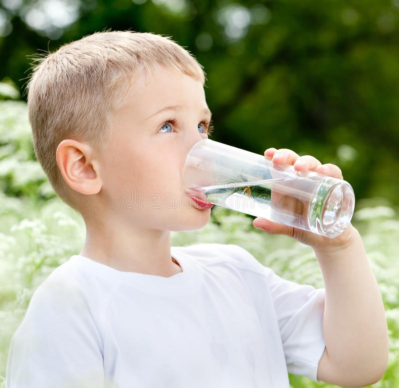 Child drinking pure water stock photos