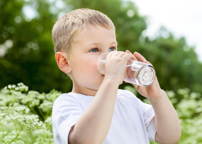 Child drinking pure water stock images