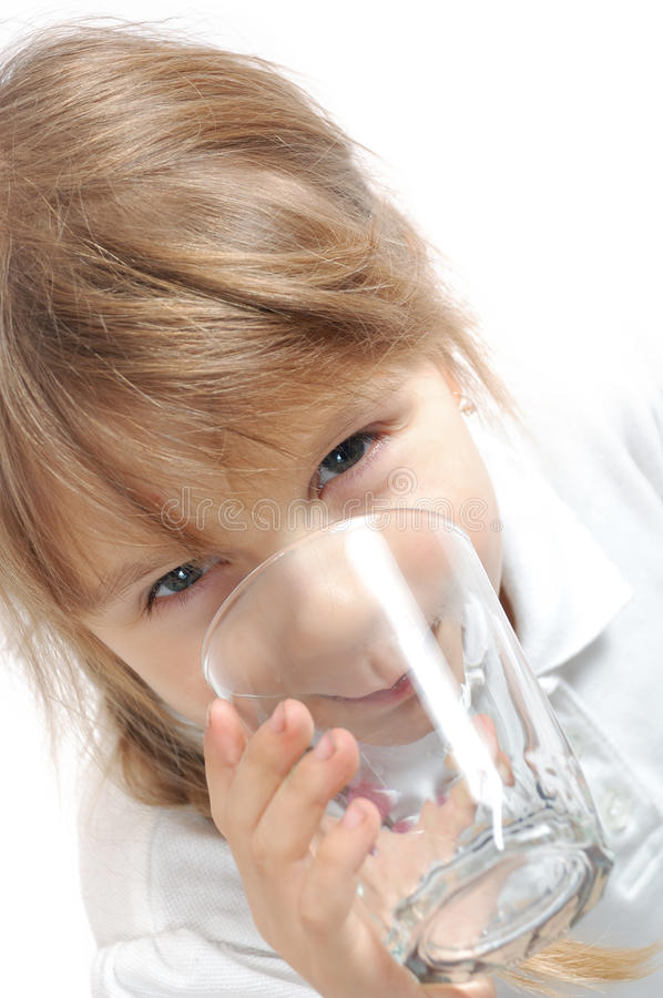 Child drinking water. Isolated over white stock images