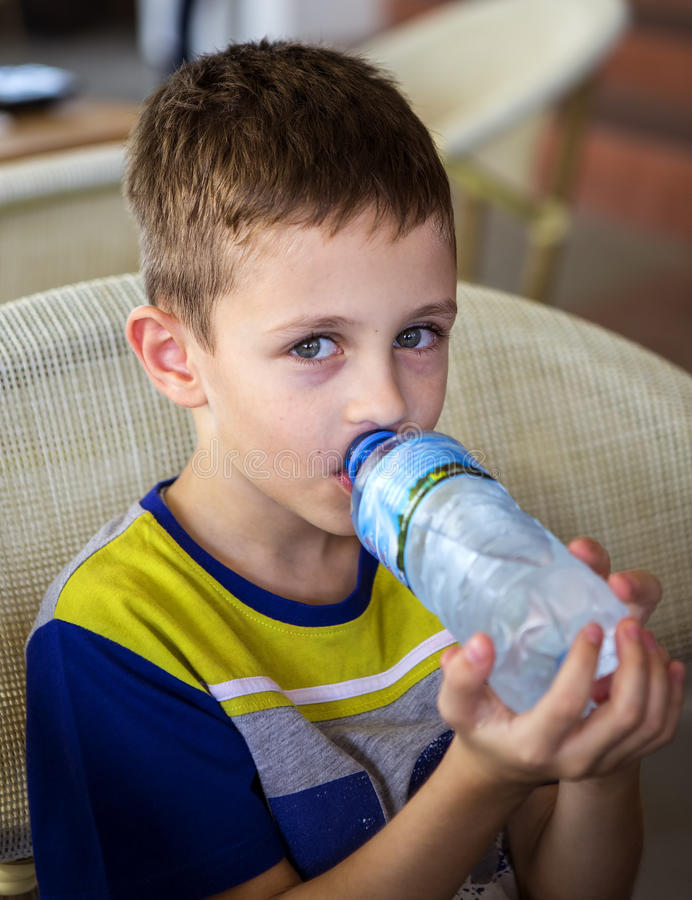 Handsome boy drinking water royalty free stock photo