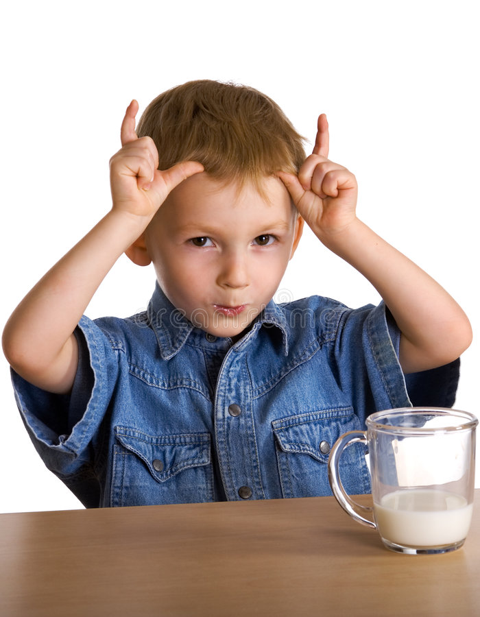 Child drinks milk shows horns royalty free stock photos