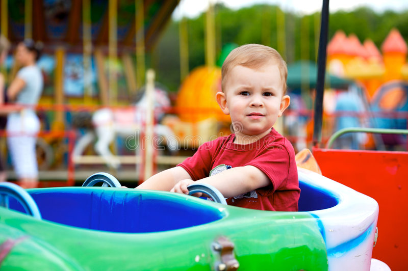 Child driving toy vehicle stock images