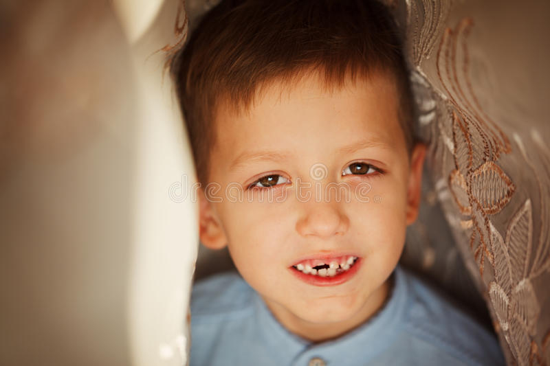 The child dropped the first milk tooth. royalty free stock images