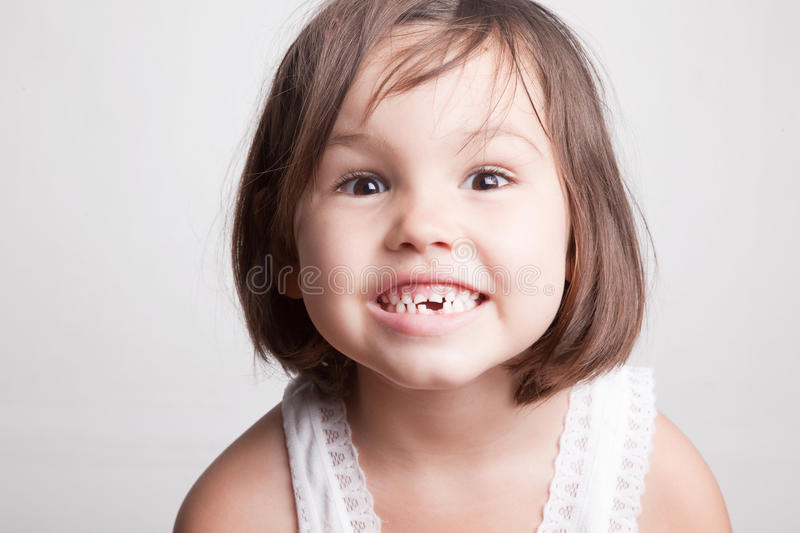 Child dropped the first milk tooth royalty free stock photos