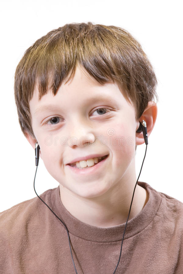 Child with earbuds stock photography