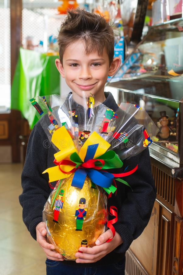 Child with easter egg in the store stock image